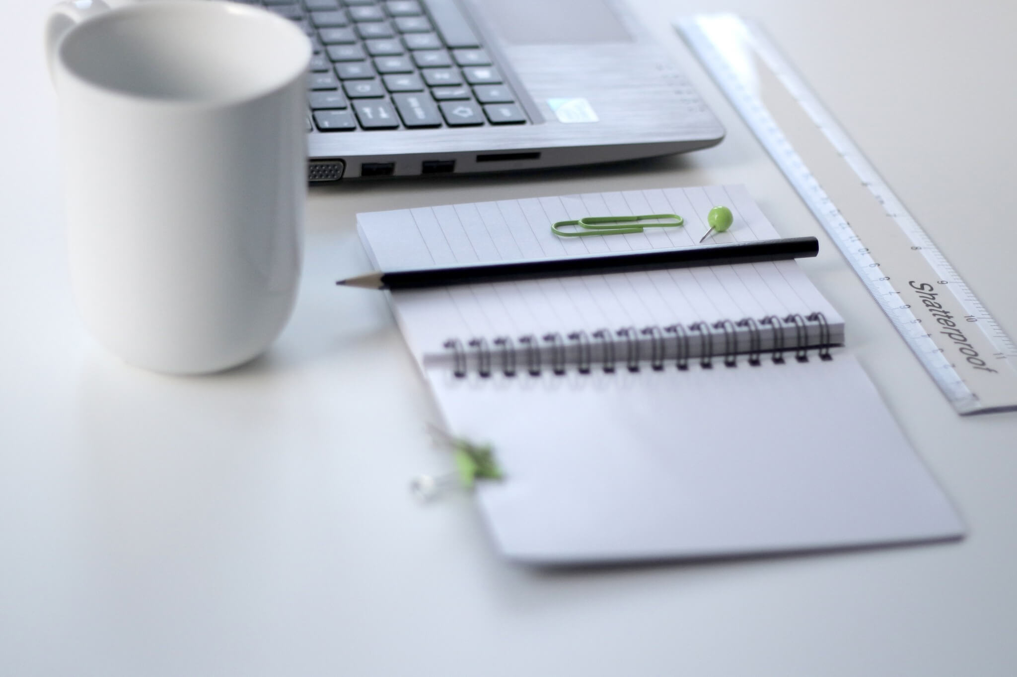 Notebook and notes at Desk